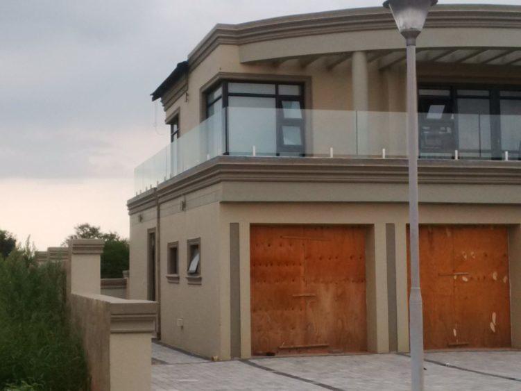 House with frameless glass balustrade