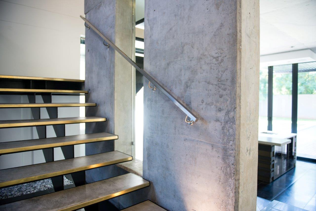 brown residential timber staircases manufactured and installed by steel studio
