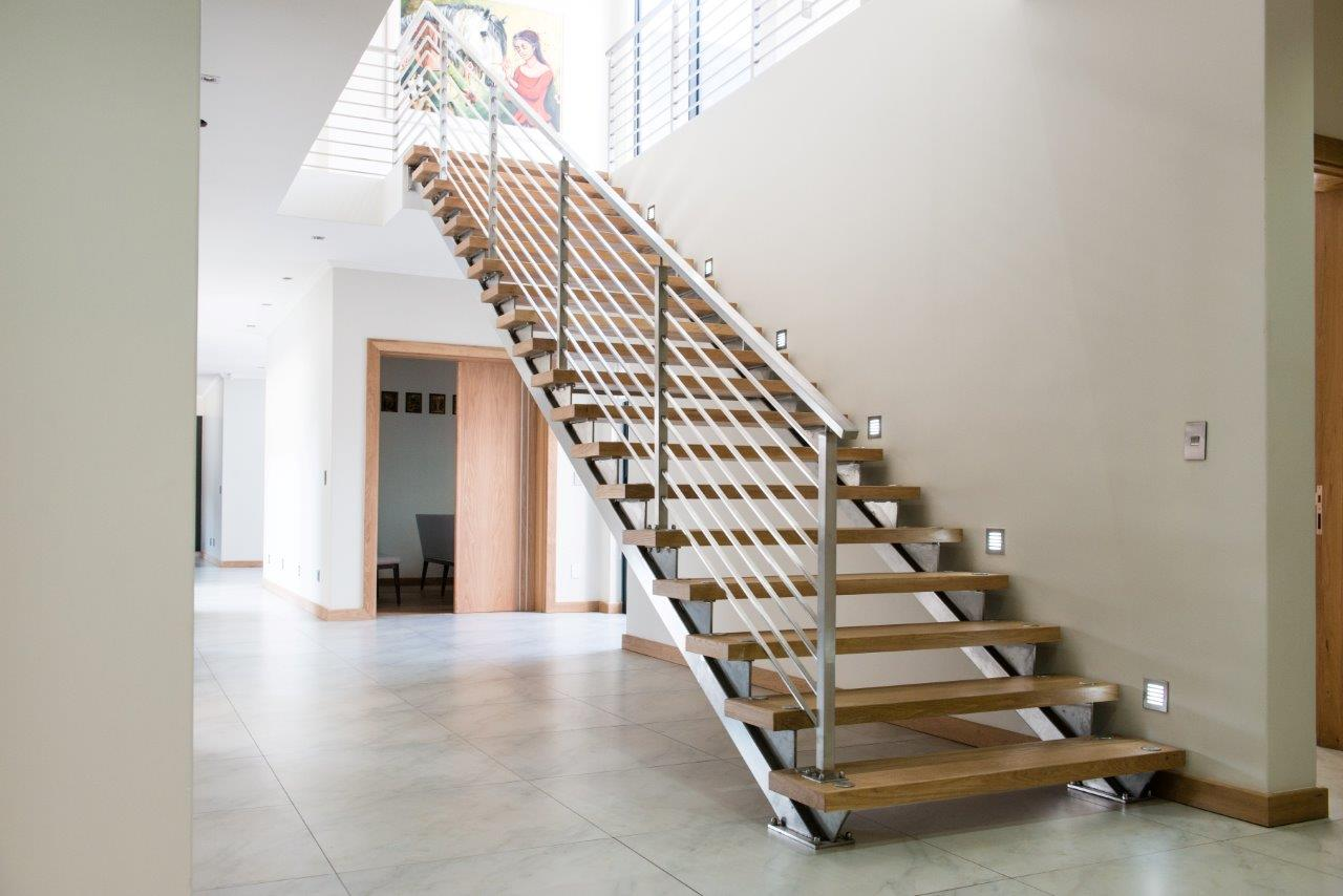 light brown residential staircase manufactured and installed by steel studio