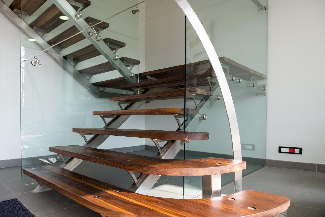 brown wooden residential staircase manufactured and installed by steel studio